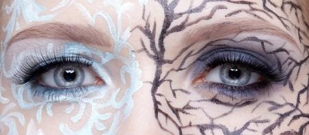 duality: close up of girls eye zone bodyart