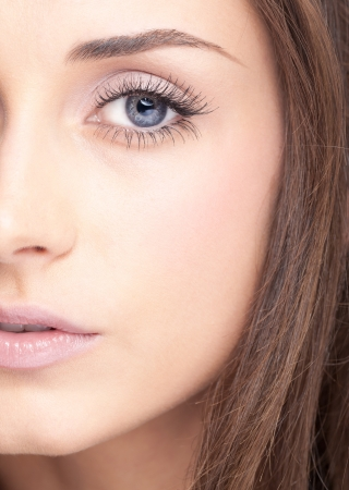 Face of young beautiful woman with day makeup