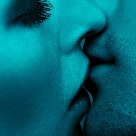 close up portrait of young caucasian couple kissing photo