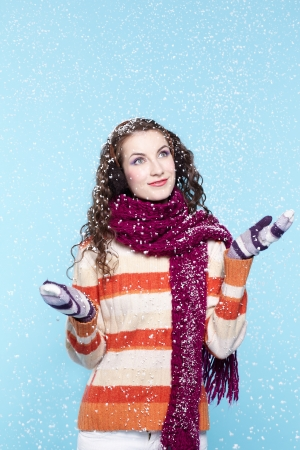 Winter portrait of young woman with snow photo