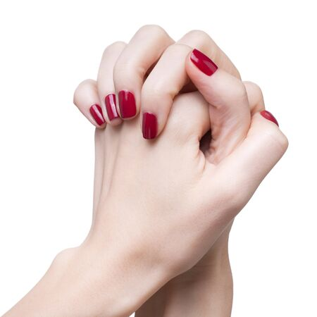 naildesign: hands with womans professional red nails manicure isolated on white