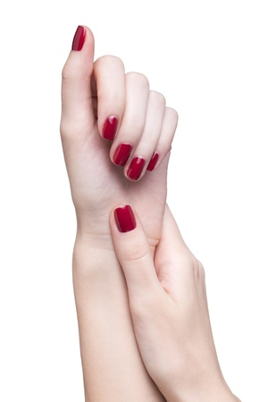 hands with woman's professional red nails manicure isolated on white Stock Photo - 17460659