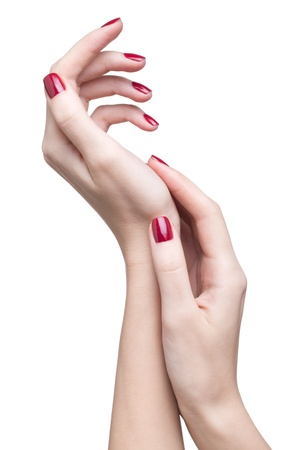 hands with woman's professional red nails manicure isolated on white Stock Photo - 17460662