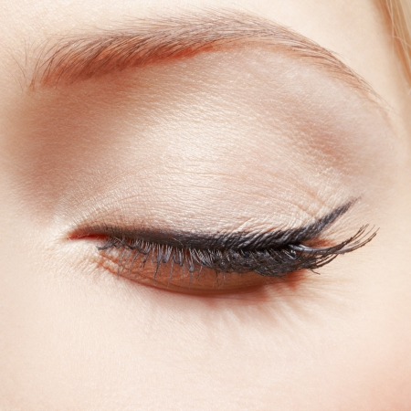 close-up portrait of young womans eye zone make up with eye shut