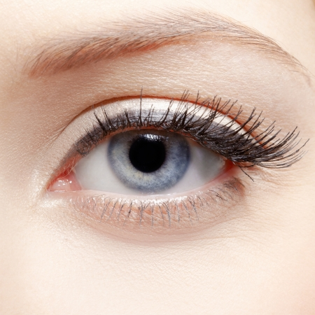 close-up portrait of young womans eye zone make-up