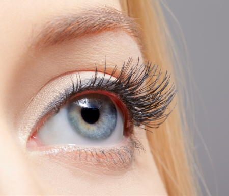 close-up portrait of young womans eye zone makeup photo