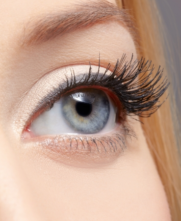 close-up portrait of young woman's eye zone make up