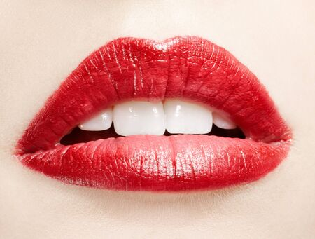 close-up portrait of young woman's lips zone make up photo