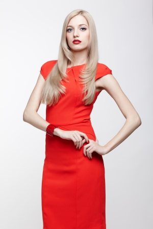 portrait of young beautiful blonde woman in red dress Stock Photo - 17566763