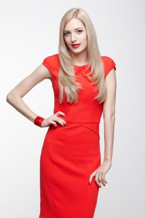 portrait of happy young beautiful blonde woman in red dress Stock Photo - 17566790
