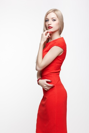 portrait of young beautiful blonde woman in red fancy dress