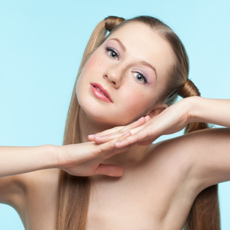 beautiful armpit: Beautiful playful freckled girl on blue background