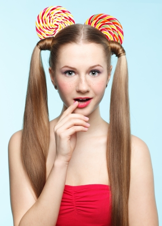 joking: Funny portrait of young woman with sugarplum ears