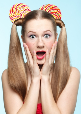 Funny portrait of young woman with sugarplum ears photo
