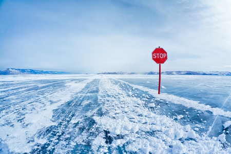 tourism russia: Prohibitive Stop traffic sign on Baikal ice crossing to Olkhon island Stock Photo