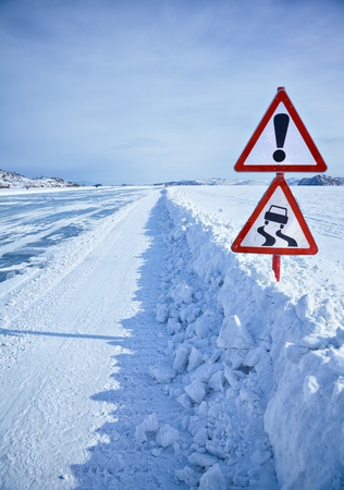 Warning traffic sign on Baikal ice crossing to Olkhon island photo