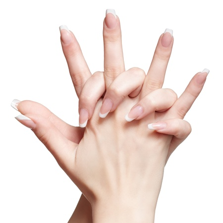 closeup shot of young womans healthy hands with french manicure on white photo