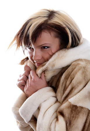 Portrait of frozen girl in fur coat  photo