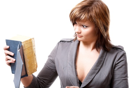 Young girl with a book isolated at the white background photo