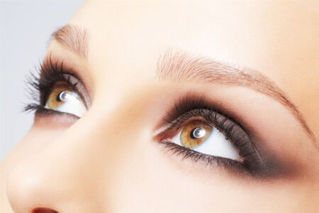 close-up portrait of beautiful young womans eye zone make-up