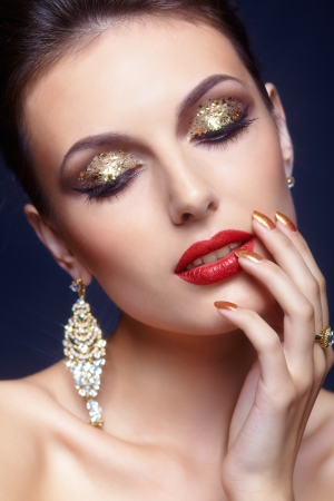 Beautiful young woman with shining face makeup  photo