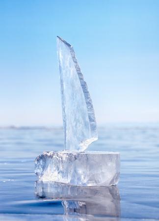 Yacht made of ice blocks on winter lake Baikal  photo