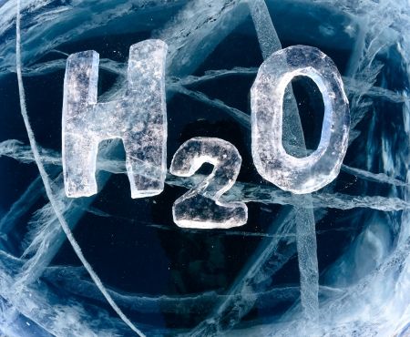 Chemical formula of water H2O made from ice on winter frozen lake Baikal  photo