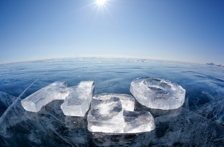 ice surface: Chemical formula of water H2O made from ice on winter frozen lake Baikal