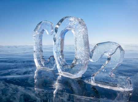 dioxide: Chemical formula of greenhouse gas carbon dioxide CO2 made from ice on winter frozen lake Baikal under blue sky  Stock Photo