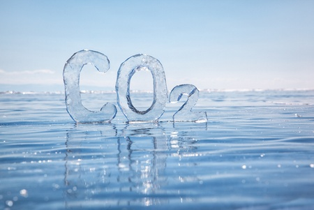 greenhouse effect: Chemical formula of greenhouse gas carbon dioxide CO2 made from ice on winter frozen lake Baikal under blue sky  Stock Photo