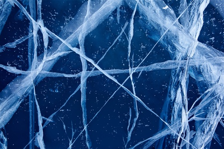 interstice: frozen pure ice of Baikal lake with many cracks Stock Photo