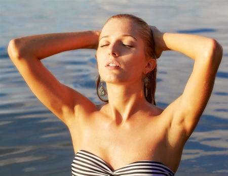 beautiful armpit: portrait of young beautiful blonde woman in sea waters