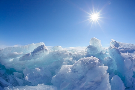 青空の太陽と冬のバイカル湖湖風景 写真素材