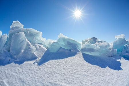 floe: Winter Baikal lake landscape with Sun on blue sky Stock Photo