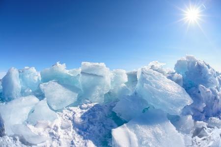 Winter Baikal lake landscape with Sun on blue sky photo