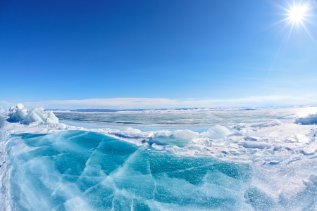 polar climate: Winter Baikal lake landscape with Sun on blue sky Stock Photo