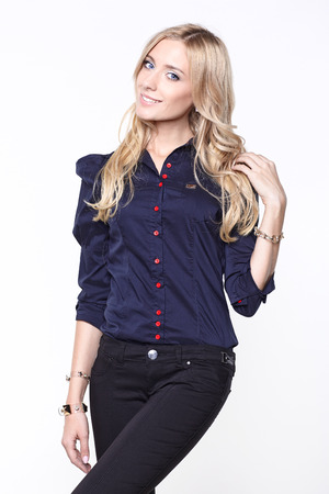 lovely blond woman in shirt and trousers photo