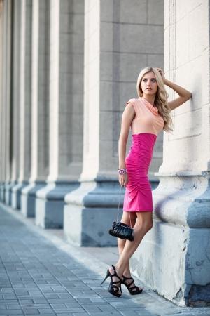 Beautiful young woman standing photo