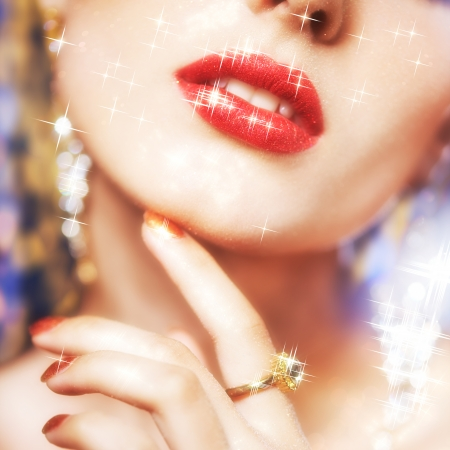 Soft focus portrait of beautiful young woman with shining face makeup  photo