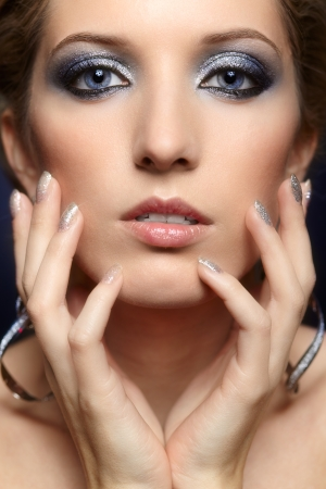 Beautiful young woman with vogue shining sparkle face makeup  photo