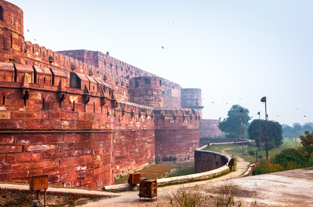 High walls of Red Agra Fort in morning mist  Uttar Pradesh, India photo