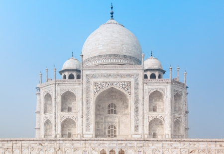 Taj Mahal in India under blue sky, front view