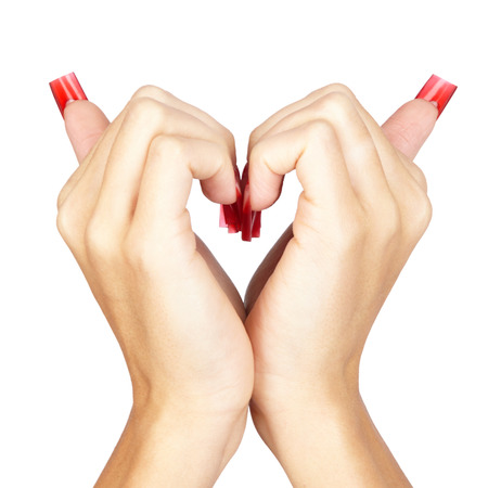 french model: Heart sign by hands with red french acrylic nails manicure  isolated white
