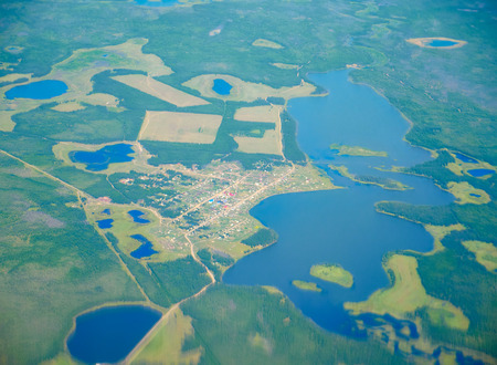 swamped: Aerial view on North Yakutia taiga and tundra landscapes from  airplane  Stock Photo