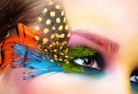 Woman with bright stylish make-up and false fashion feather eyelashes  photo