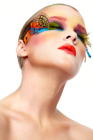 Young woman with long neck, bright stylish make-up and false fashion feather eyelashes  photo