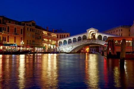 Night shot of Rialto Bridge   Ponte Rialto   on Canal Grande in Venice, Veneto, Italy photo