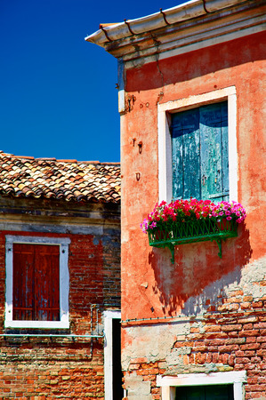 parget: Murano old buildings and closed windows with sun blinds, Veneto, Italy Stock Photo