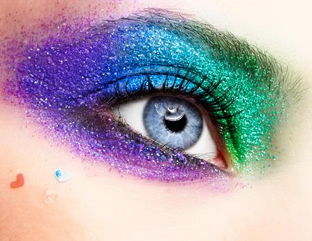 Shining holiday spangled female eye makeup  photo