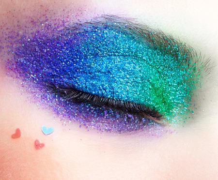Shining holiday spangled female eye makeup